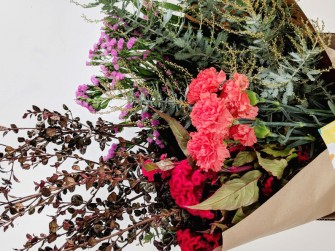 carnations acacia statice arrangement
