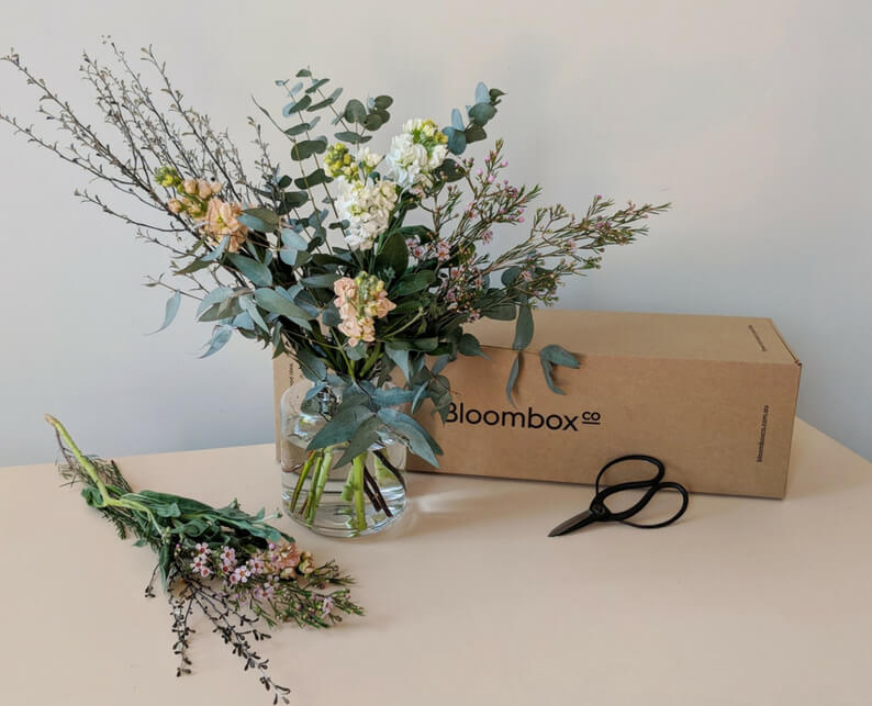Pastel flower arrangement with Stock, Eucalyptus, Waxflower and Corokia - Bloombox Co weekly delivery