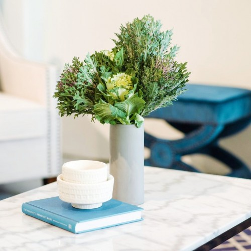 Ornamental Kale ceramic vase on coffee table