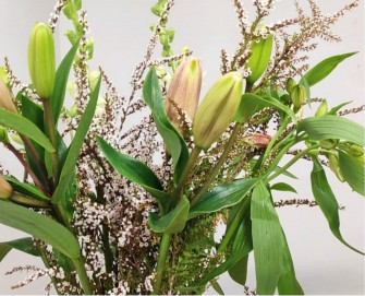 lilies and thryptomene arrangement