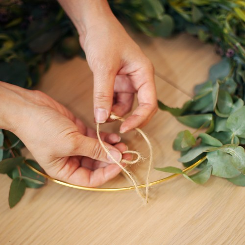 Add twine to your wreath to hang